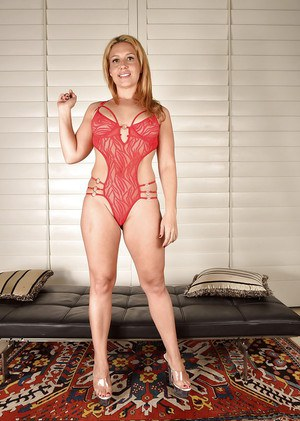 Leggy older solo model Stevie Lix removing lingerie to expose ass and pussy