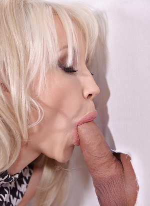 Buxom blonde Sandra Star getting chipmunked by big cock at gloryhole