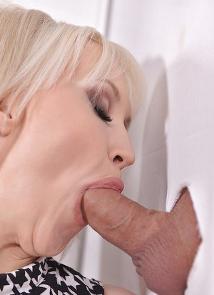Big boobed blonde Sandra Star giving blowjob at gloryhole in high heels