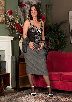 Stocking and high heel attired mature woman shows of sexy legs and beaver