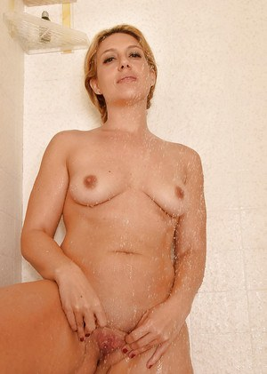 Wet mature woman Stevie Lix revealing shaved pussy in shower
