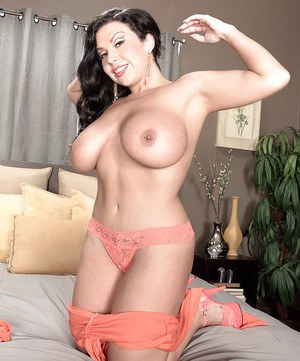 Chubby brunette MILF Sheridan Love unveiling massive boobs and pierced nips