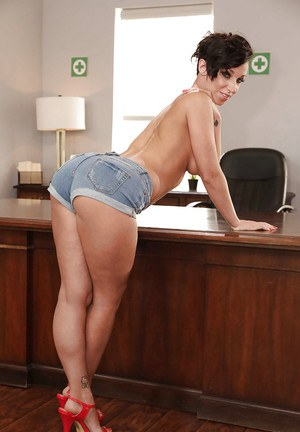 Solo girl Jada Stevens removes shorts to expose nice ass and tits in office