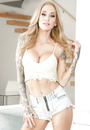 Tattooed amateur babe Sarah Jessie frees big tits and strips off shorts