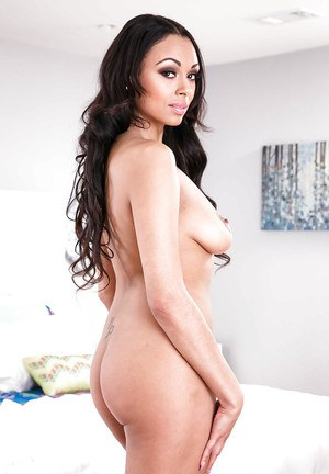 Busty brunette black babe Bethany Benz freeing ass and shaved pussy