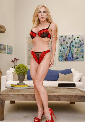 Clothed mom Amber Lynn showing off shapely legs and ass in high heels