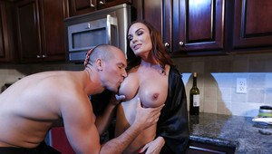 MILF pornstar Diamond Foxxx covers large tits with milk in kitchen