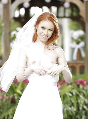 Redhead teen babe Dolly Little stripping off wedding dress outdoors