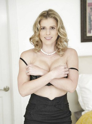 Married blonde babe Cory Chase freeing big MILF tits from lingerie
