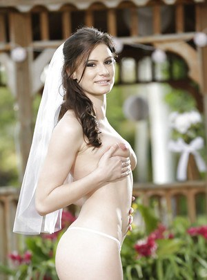 Solo girl Kymberlee Anne sheds wedding dress to expose big boobs outdoors