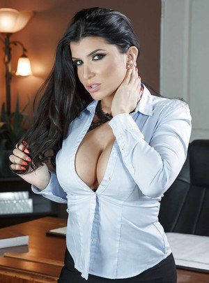 Brunette solo girl Romi Rain reveals large pornstar tits in office