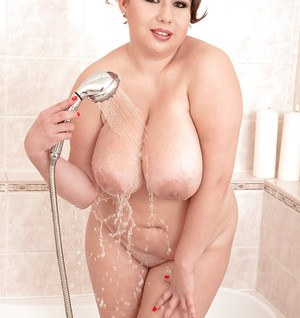 Wet BBW Monica Love showering her large saggy breasts in bathtub