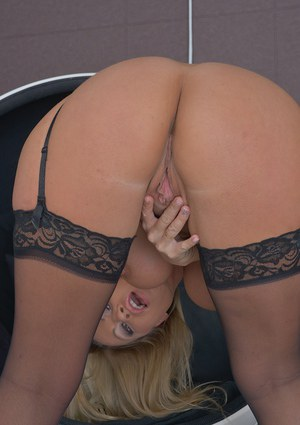 Busty blonde babe Taylor Morgan unveiling large MILF tits in stockings