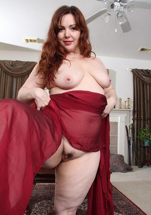 Fat redhead mom Ember Rayne revealing saggy tits and hairy vagina