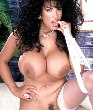 Older brunette Latina Busty Angelique unveiling massive pornstar tits
