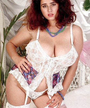 Redheaded French solo girl Chloe Vevrier flaunting huge juggs in stockings