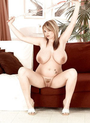Chubby blonde babe Kelly Kay baring huge hooters for nipple play