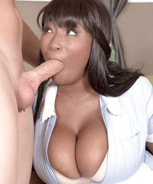 Busty ebony mom Marie Leone taking cumshot on hooters after giving handjob