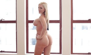 Blonde babe Alena Croft frees large MILF juggs from bra in high heels
