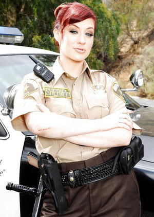 Redheaded pornstar Jessica Ryan gives interracial bj outside in cop uniform