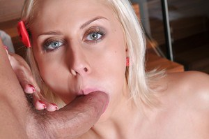 Busty blonde pornstar Mandy Dee giving blowjob during hardcore sex action