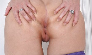 MILF babe Sheena Ryder strips off spandex pants for hairy pussy spreading