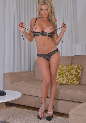 Busty blonde babe Gabriella Santorini spreading shaved pussy in high heels