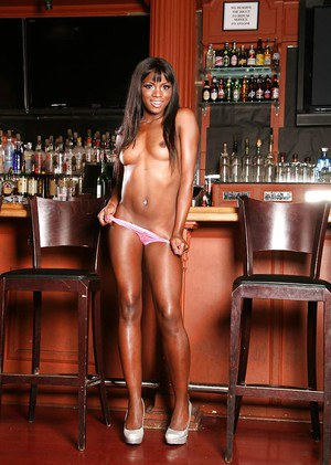 Ebony solo girl Ana Foxxx flaunts tiny pornstar boobs in high heels