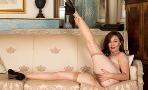 Older brunette chubby Kitty Cream spreading ass and pussy in hose and heels