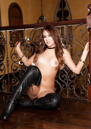 Teen centerfold babe Kalyn DeClue strutting in leather stripper boots