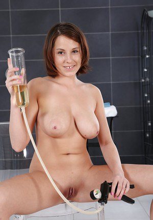 Busty Euro babe toys and masturbates shaved twat in shower before peeing
