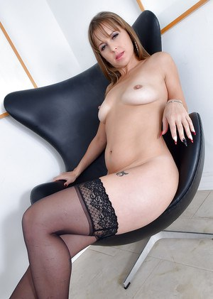 Stocking clad older lady Miss MelRose revealing small tits beneath lingerie