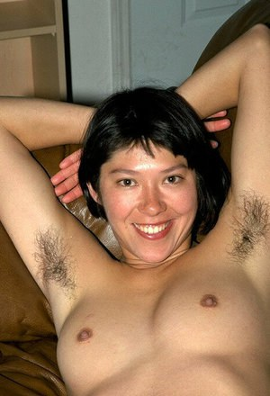 Amateur Latina chick shows off furry underarms and hairy vagina