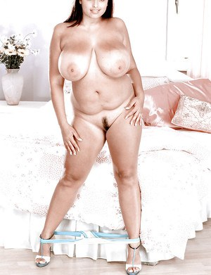 Chubby Latina Kerry Marie bares huge MILF tits before spreading hairy pussy