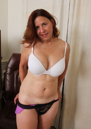 Busty mature Bobby Jackson shedding pantyhose and lingerie while undressing