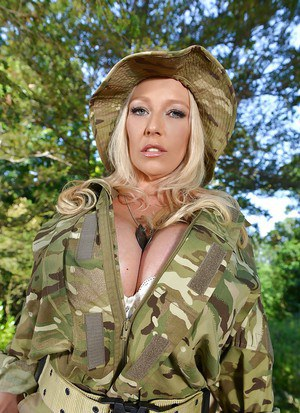 Blonde chick Delzangel freeing monster tits from military uniform in woods