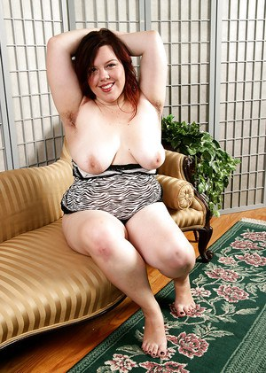 Mature BBW shows off furry underarms and saggy tits before exposing beaver