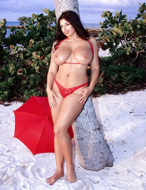 Euro chubby Kerry Marie flaunting massive pornstar tits outdoors on beach