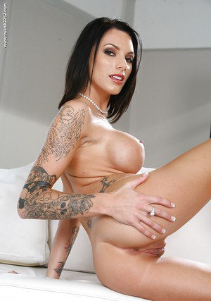 Latina solo girl Julez Ventura unveils pierced pornstar pussy and tattoos