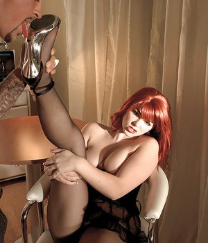 Leggy pantyhose adorned redhead Claudia Downs removes high heels