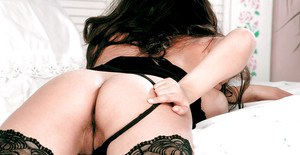 Dark haired babe Kerry Marie fondling huge boobs in stockings and heels