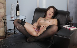 Solo girl Dusty Sunshine toys hairy vagina in stockings until she pee flows