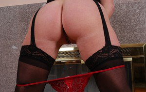 Stocking and garter adorned mature broad exposing saggy tits