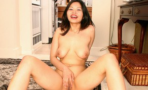 Amateur Asian babe with big natural tits spreading shaved pussy