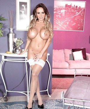 European solo girl Danniella Levy freeing monster juggs in nylons and heels