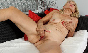 Mature blonde babe Janet Lesley masturbating shaved pussy after undressing