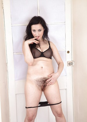 MILF solo girl shows off escaped pubic hairs beneath panties
