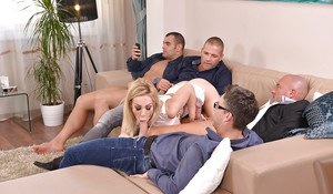 Buxom blonde Chessie Kay taking cumshots from big dicks in gangbang action