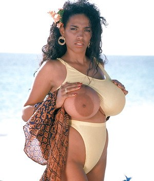 Beach babe Busty Angelique flaunting massive Latina pornstar tits outdoors
