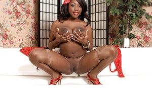 Nylon attired black MILF Janet Jade frees massive juggs for nipple play